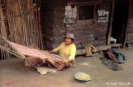 Woman weaving on a backstrap loom - © Keith Muscutt